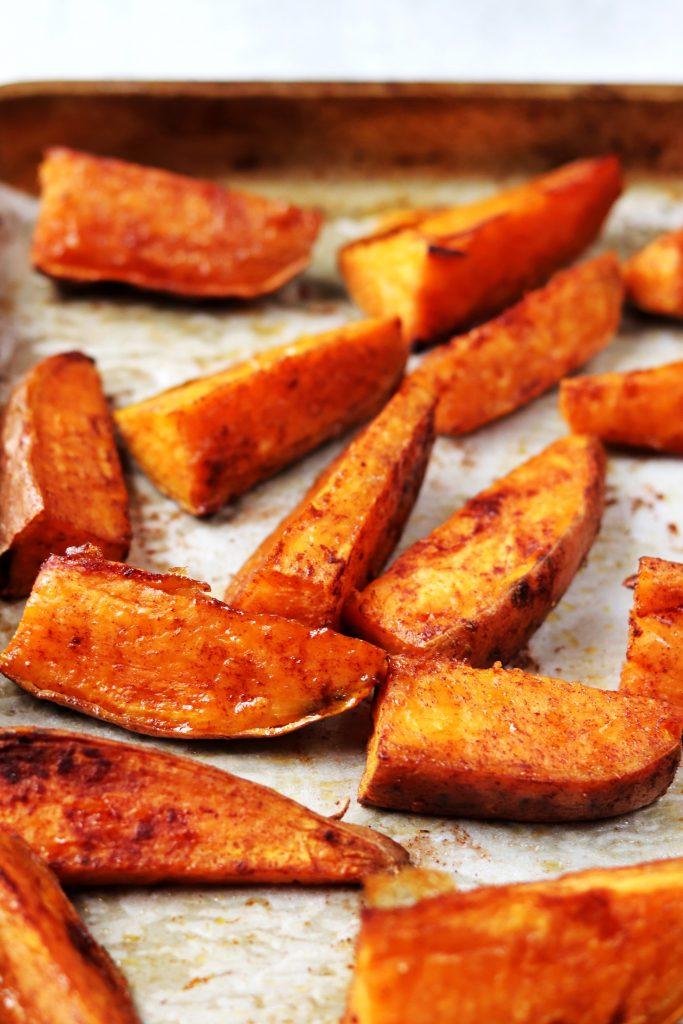 Roasted Sweet Potato Wedges on Baking Pan - Daisybeet