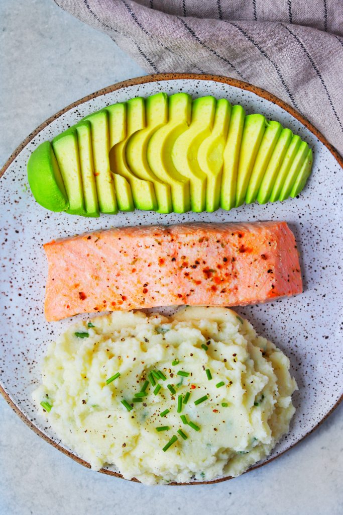Garlic and Herb Mashed Cauliflower with Salmon and Avocado - Daisybeet