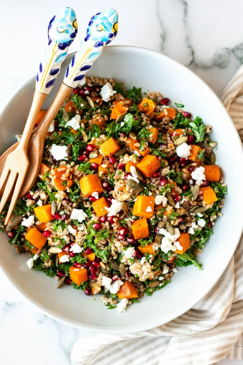Fall farro salad with butternut squash, pomegranate, goat cheese, and kale