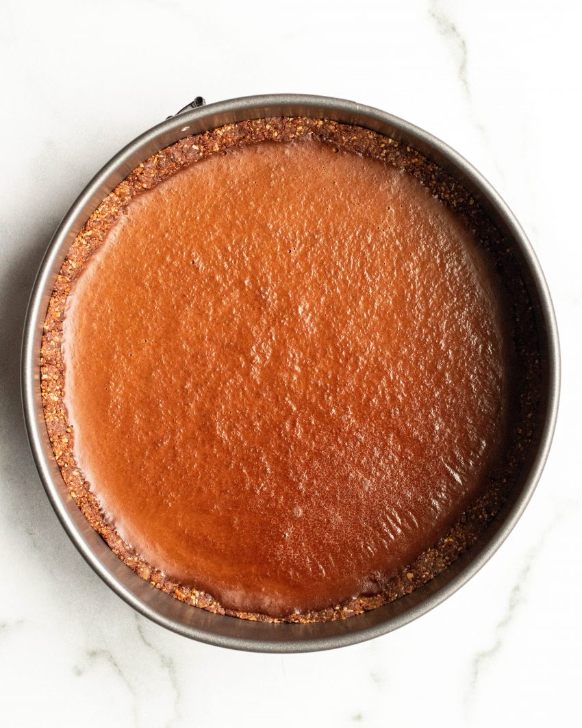 Vegan no bake chocolate peanut butter tart in a springform pan