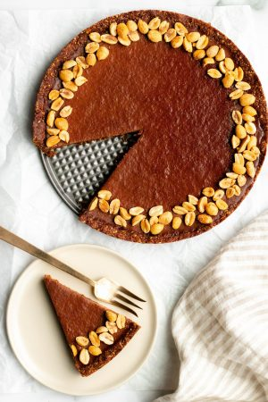 no bake chocolate peanut butter tart with one slice on a dessert plate