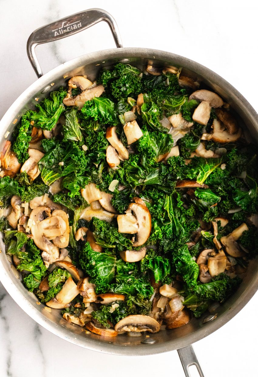 Saute pan with cooked mushrooms and kale