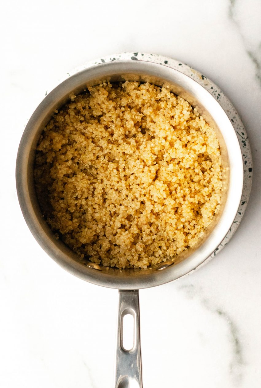 Pot filled with cooked quinoa