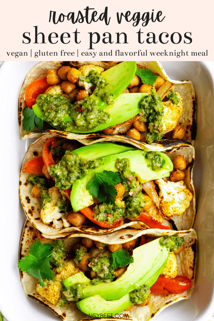Three roasted veggie and chickpea tacos in a white baking dish