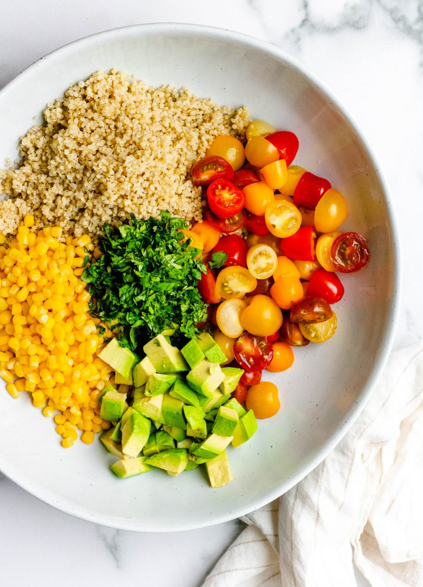 Cilantro lime quinoa salad ingredients in a bowl before being mixed together