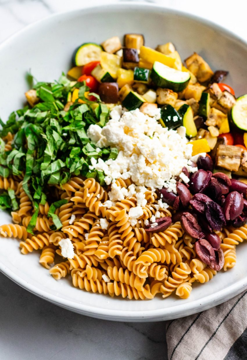 Healthy Roasted Vegetable Pasta Salad in a large bowl before being mixed up