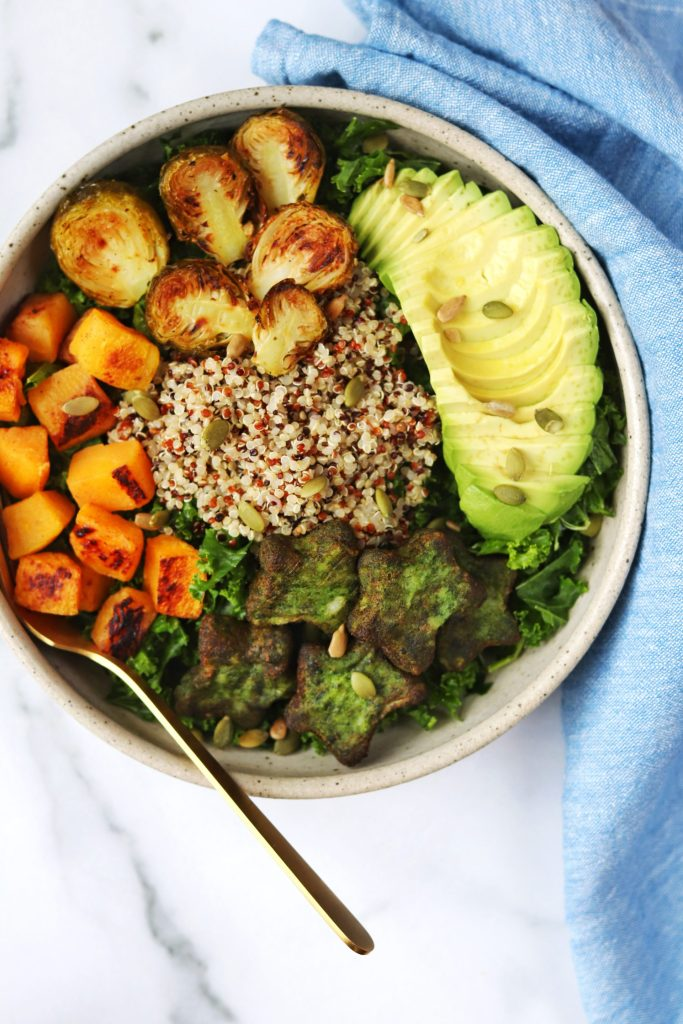 Fall kale salad with roasted fall veggies and avocado
