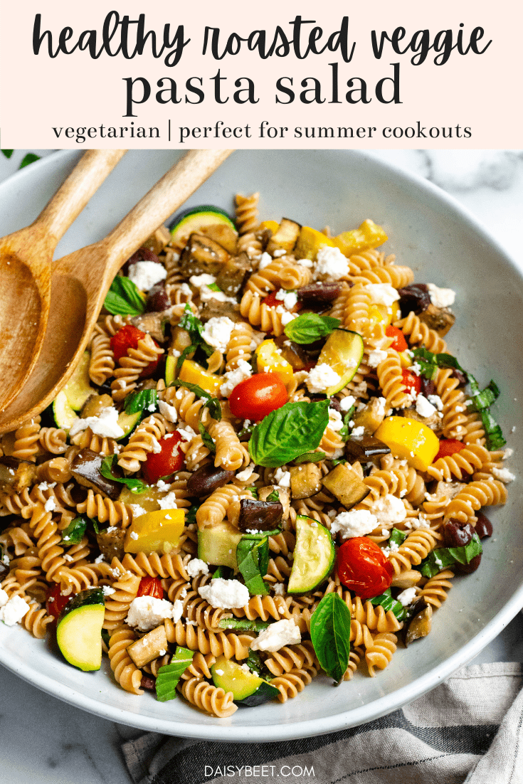 Healthy Roasted Vegetable Pasta Salad in a large bowl with wooden mixing spoons