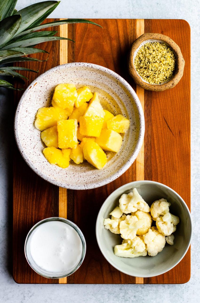 Pina colada smoothie ingredients in bowls