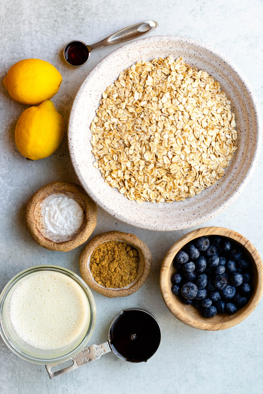 Lemon blueberry baked oatmeal cups ingredients in bowls