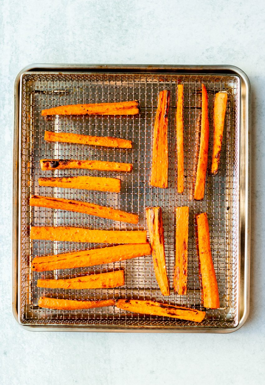 Carrot fries on an air fryer tray