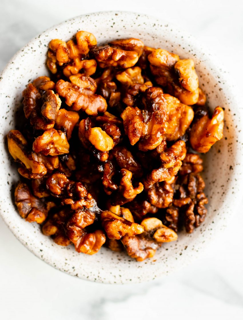 Close up of bowl of maple spice roasted walnuts