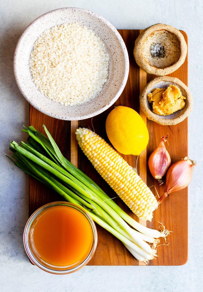 Ingredients for miso corn risotto on a wooden cutting board